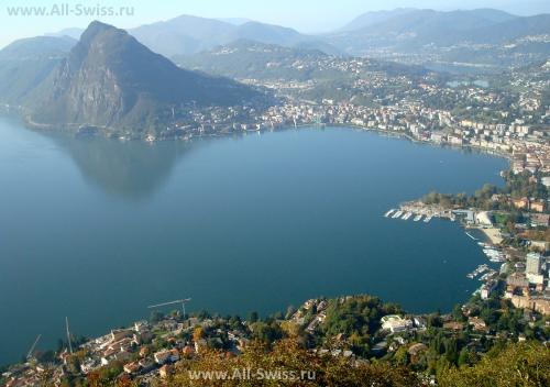 Вид на озеро и город Лугано со смотровой площадки на горе Monte Bre